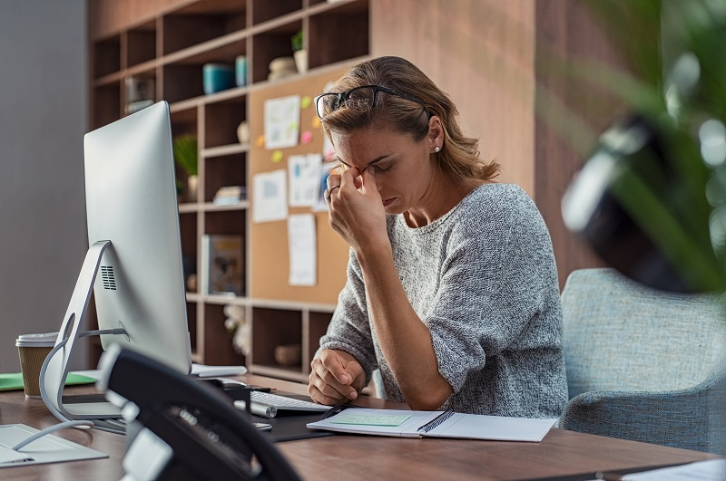 tired woman sitting at desk