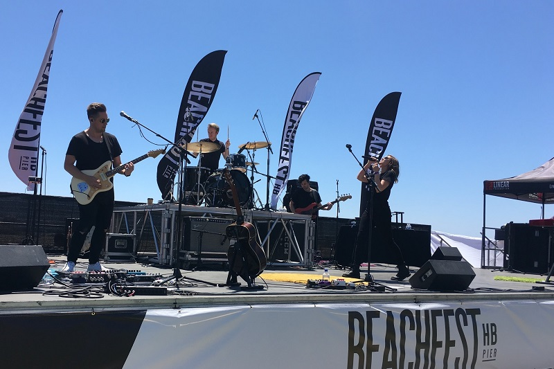 Enterline performing on stage at the 2019 Beachside Summerfest in Huntington Beach